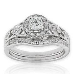 BEN BRIDGE TACOMA, WA Diamond Wedding Set 14K $2899.      Diamond engagement ring and matching wedding band, in 14K white gold. Center diamond is 1/3 carat, an...