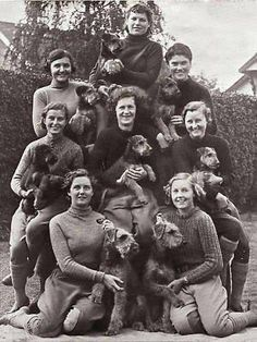 """World War II """"girls"""" with their Airedales. These Airedales were used in World War II as sentry (guard) dogs. This photo most likely is English. Members of the Women Auxiliary Territorial Services cared for the dogs and exercised them; although the actual training was done by men (remember, this was in the forties). Source: Obee Designs"""