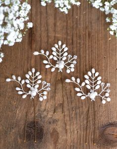 Flowing Vine Set of 3 hair pins made with beautiful freshwater pearls and sparkling Swarovski crystal beads. These pins are perfect for placing in any bridal or bridesmaid hairstyle. Please message for alternative quantities and colours. All items are wrapped and boxed.