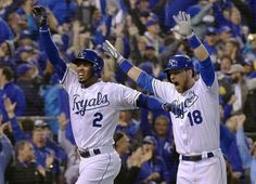 Kansas City Royals shortstop Alcides Escobar runs in while second baseman Ben Zobrist celebrated after Escobar hit an inside the park homerun on the first pitch of the bottom ot the first inning during game one of the World Series on Tuesday, October 27, 2015 at Kauffman Stadium in Kansas City, Mo.