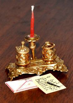 inkwell stand in Art Nouveau style with a candleholder and a pair of covered ink pots