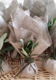 Greek wedding bombonieres with burlap fabric and olive leaf, tied in with a brown and a green suede type cord. They are filled in with 7 sugared coated almonds wrapped in a tulle. It fits perfectly to olive themed weddings. PLEASE NOTE that in the picture the favor has been