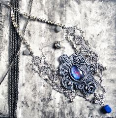 Free tutorial. Check my blog http://michellemaya2005.wordpress.com/ to see how I did the polymer clay focal for this Gothic Necklace - Once Upon a Time by Mihaela Georgescu