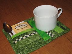 this would make a sweet gift.  I like the way it holds a tea bag.