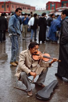 Musicians paint their pictures on silence. - Leopold Stokowski -Morroco - By Steve McCurry