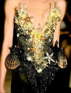 District four chariot dress. I am going for a king and queen of the sea theme.