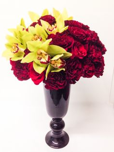 Long-Stem Red Roses with Dancing Orchids by Gabriela Wakeham Floral Design in New York City. Available for same-day flower delivery in NYC.