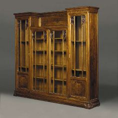 'Modèle Junko' Glazed Walnut Cabinet  DESIGNED BY LOUIS MAJORELLE, CIRCA 1905