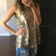 Lacy Parker Top In excellent like new condition. Purchased from another posher but can't pull the swing top look. Beautiful shimmering and subtle camo-ish print. Perfect for dressing up holiday attire or wear with an oversized BF jacket and skinny jeans. Lacy Parker Tops