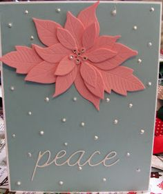 Poppy stamps Poinsettia die and Memory Box Peace die.  Opal Liquid pearls for snow.