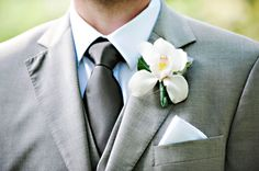 Adeline and Grace Photography | Keeping it simple in gray and white, with a single orchid | Boutonniere by Sayles Livingston Flowers www.sayleslivingstonflowers.com