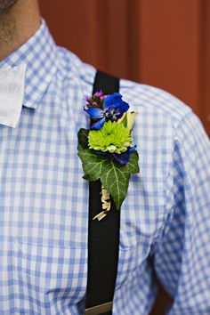 boutonniere with ivy, photo by Kelly Ginn Photography http://ruffledblog.com/memphis-farmers-market-wedding #weddingideas #grooms #boutonnieres