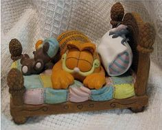 """Garfield Figurine: """"Catnap"""" in Hiden_Treasures7641's Yard Sale in Arlington , TX for $10. Danbury Mint limited addition Jim Davis Garfield Collectable Figurine!Add one or more of these vibrantly colored figurines to your collection for only 10.00 each! Each mini statue measures approximately 4 1/2-inch tall, and feature that grumpy adorable cat that we all know and love, doing what he does best! All items are in excellent or very good condition! Unfortunately, due to privacy, item% ..."""
