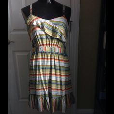 Striped ruffle top spaghetti strap dress A gorgeous sundress with ruffle top and ruffle hem bottom. Straps are adjustable. Dress measures 18 in. In length from waist. Wear now and west through fall by adding a cardigan or jacket and boots. Worn only a couple of times. Xhilaration Dresses