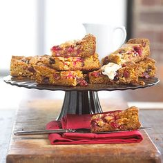 Cranberry Blondies - Made from fresh, simple ingredients, these festive cranberry-and-vanilla brownies will shine on any holiday table. White chocolate and cinnamon whipped cream add extra sweetness.  See Cranberry Blondies recipe