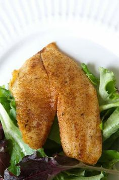 This is a very simple baked tilapia recipe with only six ingredients but the end dish is incredibly good. Tilapia has a mild, soft flavor, which combines well with either gentle sauces, or just butter, garlic, and herbs like in this baked tilapia recipe.