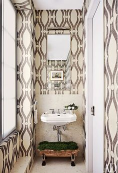 Installing wallpaper in a diminutive space can give it a jewel-box effect; in some cases, as in this bath designed by Bureau d'Architecture Marc Corbiau and Timothy Whealon, it can also make the room appear larger than it is | archdigest.com