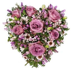 A beautiful and luxurious heart shaped tribute designed with lilac roses.
