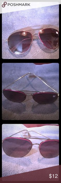 Hello Kitty Sunglasses Beautiful Pink Hello Kitty Sunglasses in great condition, Gold and Pink Trimmed Lenses. Accessories Sunglasses
