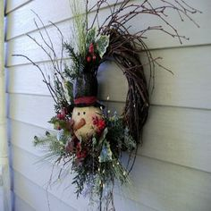 Wreath with Snowman by CerridwensGardens on Etsy
