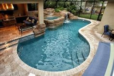 Covered patio area incorporated next to/into the pool border