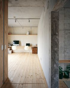 I like how bright it is, the wood floor gives warmth but the concrete grounds it.