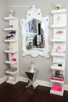 mirror in the middle of vertical bookshelves-- maybe not as long though. great idea. room décor