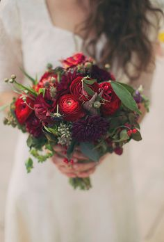 Brides: Red Bouquet of Peonies. Bouquet of dahlias, ranunculuses, seeded eucalyptus, sweet pea tendrils, perennial mums, snapdragons, ilex berries, and scabiosas, $225, Greenlion Design