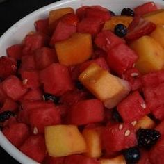 Strawberry-Melon Summer Salad: Ingredients    1 cup lemon yogurt  1 tablespoon honey  1 teaspoon lemon juice  2 cups watermelon balls  2 cups cantaloupe balls  2 cups halved fresh strawberries  Directions    In a salad bowl, whisk together the lemon yogurt, honey, and lemon juice until smooth, and gently fold in the watermelon balls, cantaloupe balls, and strawberries. Toss to coat, and serve.