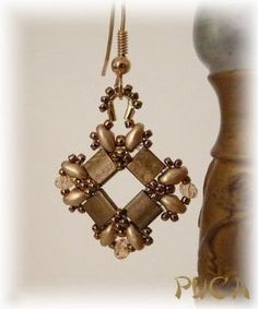 """""""Tila earring - no tute but notice how a wire guard is used and embellished to turn a component into an earring.  very clever.  #Seed #Bead #Tutorials"""" by Shopway2much"""