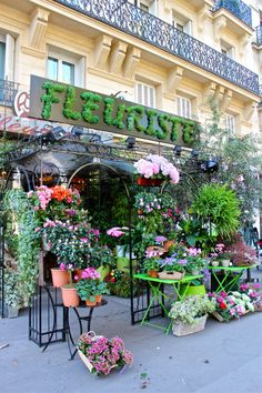 Love all the flowers in the front of this flower shop!