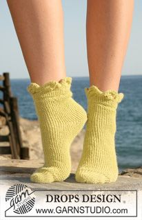 """DROPS sock knitted from side to side with leaf pattern in """"Alpaca"""". Size 35-42. (DROPS ALPACA from Garnstudio 100 g for all sizes colour no 7300, lime DROPS POINTED NEEDLES size 2.5 mm - or size needed to get 26 sts x 52)"""