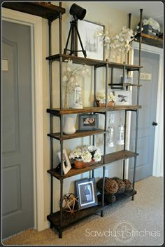 "build an industrial shelf using PVC pipe, Sawdust 2 Stitches on Remodelaholic -- Yay! I now see how I can afford to add ""industrial"" bookshelves to both sides of the huge entertainment armoire in my living room! Industrial Shelving, Industrial Style, Industrial Pipe, Industrial Design, Industrial Interiors, Industrial Office, Industrial Lighting, Shelving Decor, Industrial Decorating"