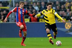 Thomas Mueller of Muenchen vies with Mats Hummels of Dortmund during the Bundesliga match between Borussia Dortmund and FC Bayern Muenchen at Signal Iduna Park on April 4, 2015 in Dortmund, Germany.