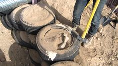 building an Earthship is NOT on my to-do list but this video has great tips ~ like putting cardboard in the bottom of the tires before you fill them ~ that were VERY helpful when I built my tire retaining wall