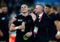 Sheer delight marks Carter's face after full-time at Twickenham as he celebrates with All Blacks media manager Joe Locke on the pitch