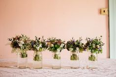 wedding bouquets in a row - flowers by Catkin