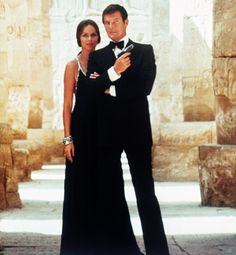 As the Russian KGB agent Anya Amasova, actress Barbara Bach arguably wore the most notable Bond-girl evening dress in The Spy Who Loved Me (1977). Long, black and lined along the straps and neckline with diamonds, the slinky getup helped the Soviet spy easily woo Bond, James Bond.
