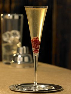Ruby Slippers- Citrus vodka,peach liqueur,white cranberry juice,champagne, garnish with pomegranate seeds