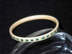 Small Bakelite Bangle with Green Shiny Rhinestones now on SALE at http://www.BanglesandBeadsOnline.com.