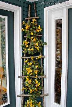 On both sides of the front doors in gorgeous pots for spring!  Ashbee Design: Ladders in Décor