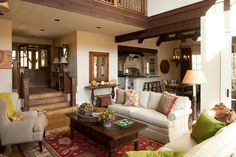 Although less than 2,500 square feet, this cottage feels larger because of the homeowners' clever decision to open up and connect the main living spaces. The family room is also vaulted to reveal the loft space above―yet another way of providing extra volume to a relatively modest space.  See this Appalachian Style Cottage
