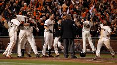 The San Francisco Giants celebrate their 6-3 win against the St. Louis Cardinals in Game 5 to win the National League baseball championship series in San Francisco, Calif., on Thursday, Oct. 16, 2014.  (Nhat V. Meyer/Bay Area News Group)