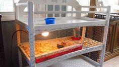 A changing table converted to a chick brooder. I have one of these lying around not being used ;)