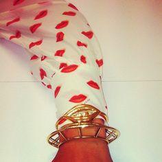 Aurélie Bidermann Lip Bracelet + Prada Shirt