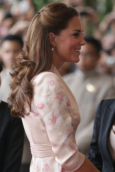 Side view of Kate Middleton's hair. Jenny Packman dress again.