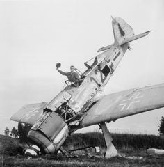 An American soldier poses in a Focke-Wulf Fw 190 at the Pocking airfield.