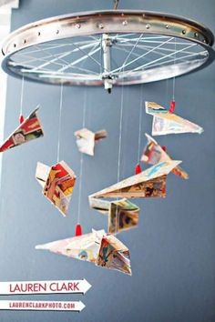 DIY mobile paper airplanes on bike wheel.... an entire page of awesome ideas for mobiles