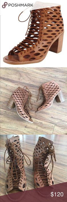 Jeffrey Campbell Cors Bootie Laser-cut perforations amp up the drama on a stunning lace-up bootie grounded by a bold, sturdy heel. Lace-up style with back zip closure. Cognac color with wooden block heel. Minimal signs of wear. Size 9. Jeffrey Campbell Shoes Lace Up Boots