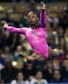 simone biles | Simone Biles, of the United States, performs her floor routine during ...